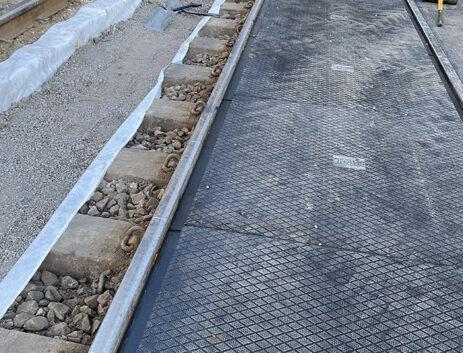 Replacing level crossing sleeper